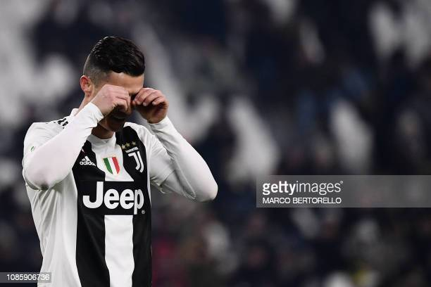 TOPSHOT Juventus' Portuguese forward Cristiano Ronaldo gestures during the Italian Serie A football match Juventus vs Chievo Verona on January 21...