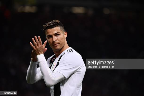 Juventus' Portuguese forward Cristiano Ronaldo gestures during the Italian Serie A football match between Inter Milan and Juventus on April 27, 2019...