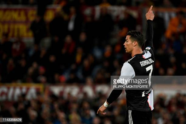 Juventus' Portuguese forward Cristiano Ronaldo gestures during the Italian Serie A football match between AS Roma and Juventus Turin at the Olympic...