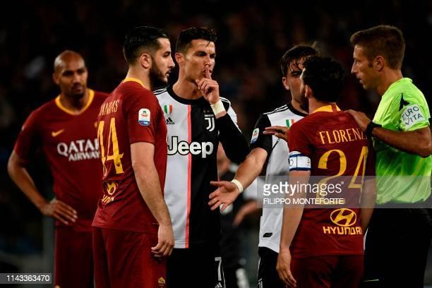 Juventus' Portuguese forward Cristiano Ronaldo gestures next to AS Roma Greek defender Konstantinos Manolas and AS Roma Italian midfielder Alessandro...