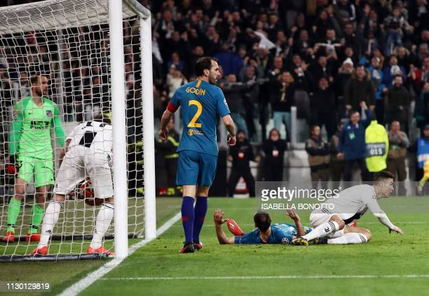 Juventus' Portuguese forward Cristiano Ronaldo gets back up after opening the scoring during the UEFA Champions League round of 16 secondleg football...