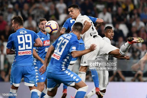 Juventus' Portuguese forward Cristiano Ronaldo goes for a header during the Italian Serie A football match Juventus vs Napoli on September 29 2018 at...
