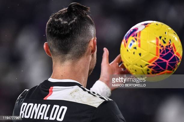 Juventus' Portuguese forward Cristiano Ronaldo grabs the ball during the Italian Serie A football match Juventus vs Parma on January 19 2020 at the...