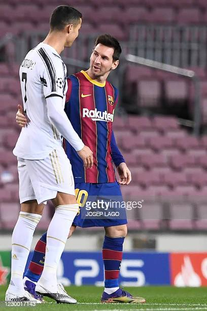 Juventus' Portuguese forward Cristiano Ronaldo greets Barcelona's Argentinian forward Lionel Messi before the UEFA Champions League group G football...