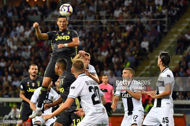 Juventus' Portuguese forward Cristiano Ronaldo heads the ball during the Italian Serie A football match Parma vs Juventus on September 1 2018 at...