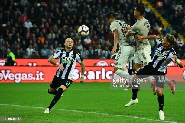 Juventus' Portuguese forward Cristiano Ronaldo heads the ball during the Italian Serie A football match Udinese Calcio vs Juventus FC at the Dacia...