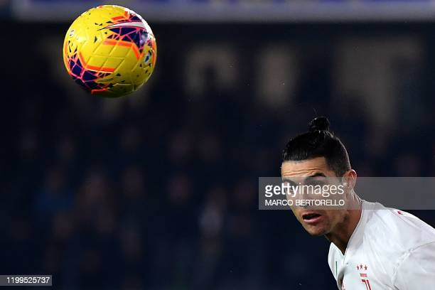 Juventus' Portuguese forward Cristiano Ronaldo heads the ball during the Italian Serie A football match Hellas Verona vs Juventus on February 8, 2020...