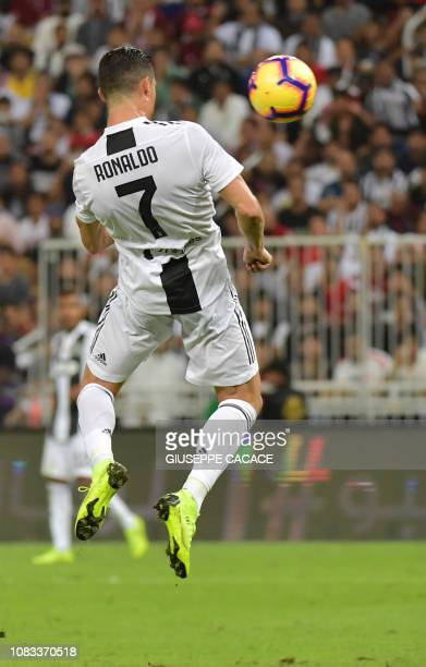 Juventus' Portuguese forward Cristiano Ronaldo heads the ball to score during their Supercoppa Italiana final between Juventus and AC Milan at the...