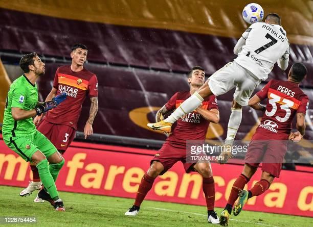 Juventus' Portuguese forward Cristiano Ronaldo heads the ball to score an equalizer past Roma's Italian goalkeeper Antonio Mirante during the Italian...