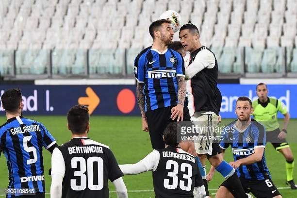 Juventus' Portuguese forward Cristiano Ronaldo heads the ball with Inter Milan's Uruguayan midfielder Matias Vecino during the Italian Serie A...