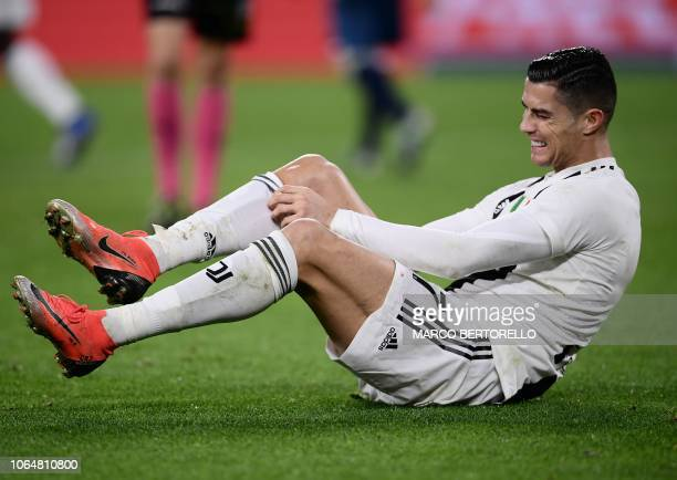 Juventus' Portuguese forward Cristiano Ronaldo holds his leg in pain during the Italian Serie A football match Juventus vs Spal 2013 on November 24...