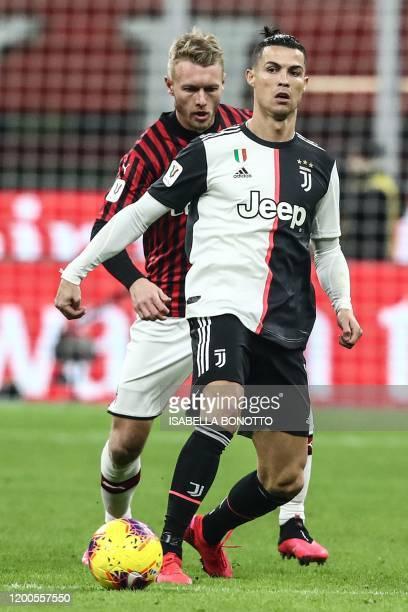 Juventus' Portuguese forward Cristiano Ronaldo holds off AC Milan's Danish defender Simon Kjaer during the Italian Cup semi-final first leg football...