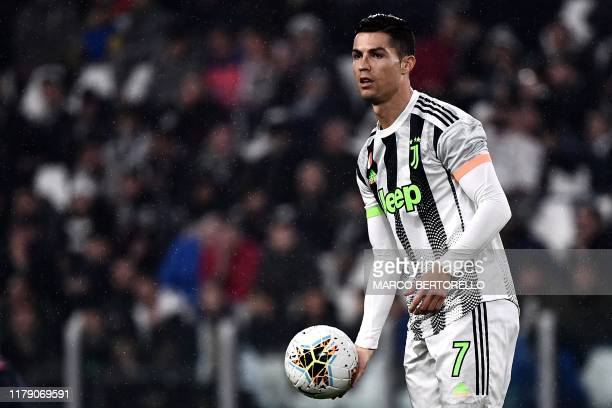 Juventus' Portuguese forward Cristiano Ronaldo holds the ball during the Italian Serie A football match between Juventus and Genoa on October 30 2019...