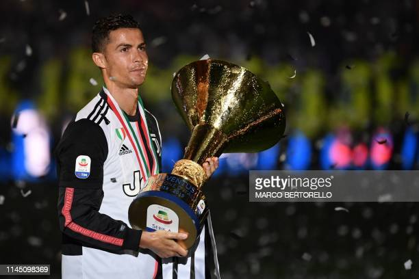 Juventus' Portuguese forward Cristiano Ronaldo holds the Italian Champion's trophy at the end of the Italian Serie A football match Juventus vs...