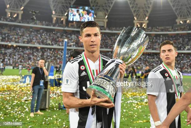 Juventus' Portuguese forward Cristiano Ronaldo holds the Supercoppa Italiana trophy after their final win against AC Milan at the King Abdullah...