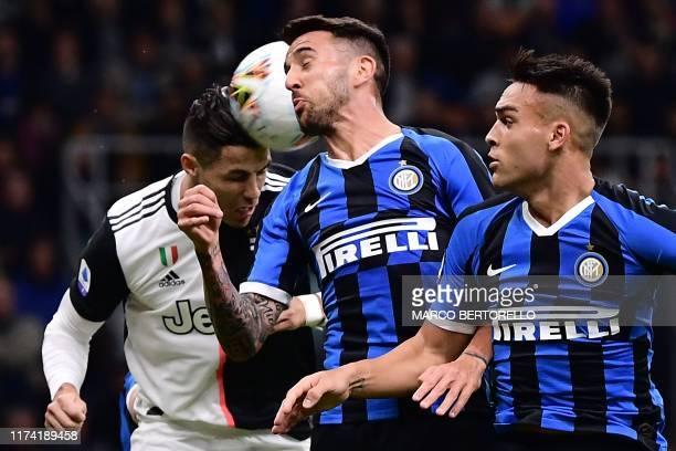 Juventus' Portuguese forward Cristiano Ronaldo, Inter Milan's Uruguayan midfielder Matias Vecino and Inter Milan's Argentinian forward Lautaro...