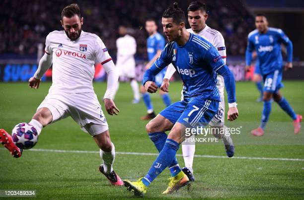Juventus' Portuguese forward Cristiano Ronaldo is challenged by Lyon's French midfielder Lucas Tousart during the UEFA Champions League round of 16...