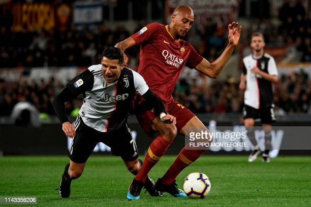 Juventus' Portuguese forward Cristiano Ronaldo is tackled by AS Roma French midfielder Steven Nzonzi during the Italian Serie A football match...
