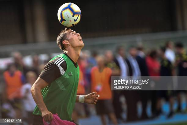 Juventus' Portuguese forward Cristiano Ronaldo juggles with a ball as he warms up prior to the Italian Serie A football match AC Chievo vs Juventus...