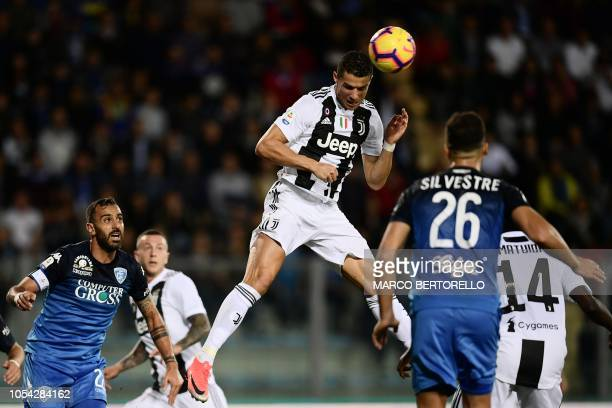 Juventus' Portuguese forward Cristiano Ronaldo jumps for the ball during the Italian Serie A football match Empoli vs Juventus on October 27 2018 at...