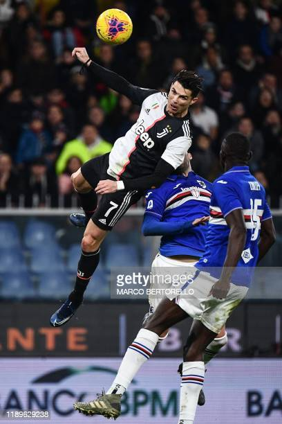 Juventus' Portuguese forward Cristiano Ronaldo jumps to score a header during the Italian Serie A football match Sampdoria vs Juventus on December...