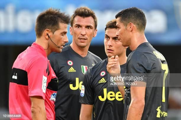 Juventus' Portuguese forward Cristiano Ronaldo Juventus' Argentinian forward Paulo Dybala and Juventus' Croatian forward Mario Mandzukic talk with...