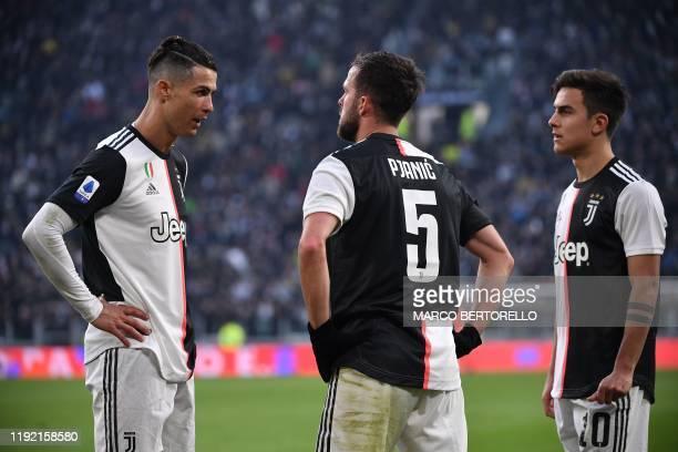 Juventus' Portuguese forward Cristiano Ronaldo Juventus' Bosnian midfielder Miralem Pjanic and Juventus' Argentine forward Paulo Dybala react during...