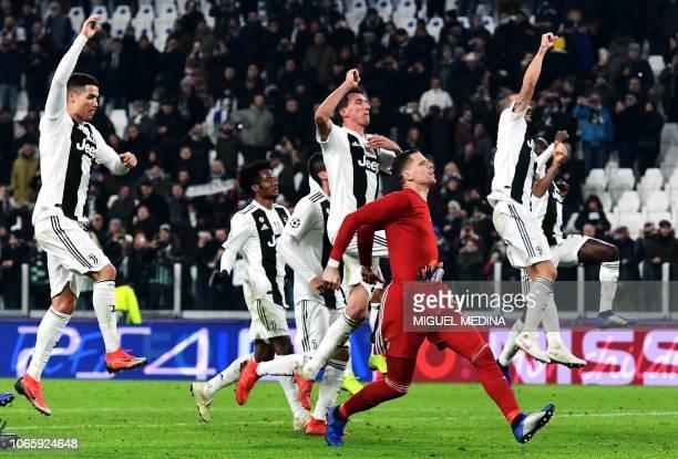 Juventus' Portuguese forward Cristiano Ronaldo Juventus' Colombian midfielder Juan Cuadrado Juventus' Croatian forward Mario Mandzukic Juventus'...