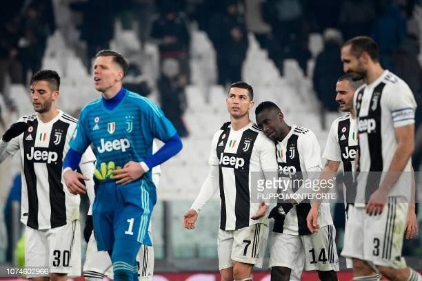 Juventus' Portuguese forward Cristiano Ronaldo Juventus' French midfielder Blaise Matuidi and teammates celebrate at the end of the Italian Serie A...