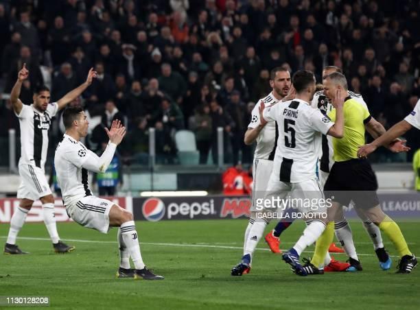 Juventus' Portuguese forward Cristiano Ronaldo Juventus' Italian defender Leonardo Bonucci and Juventus' Bosnian midfielder Miralem Pjanic contest...