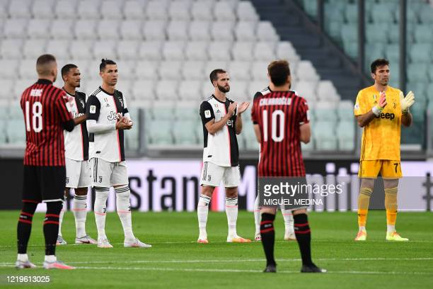 Juventus' Portuguese forward Cristiano Ronaldo , Juventus' Italian goalkeeper Gianluigi Buffon and players applaud after holding a minute of silence...