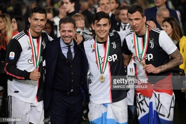 Juventus' Portuguese forward Cristiano Ronaldo Juventus technical manager Fabio Paratici Juventus' Argentine forward Paulo Dybala and Juventus'...