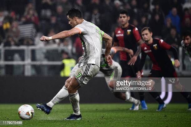 Juventus' Portuguese forward Cristiano Ronaldo kicks a penalty and scores during the Italian Serie A football match between Juventus and Genoa on...