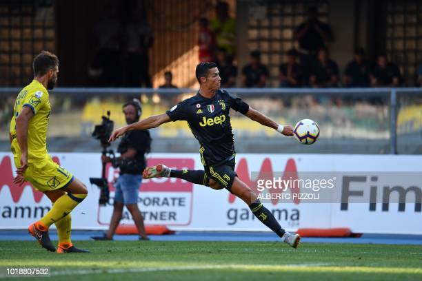 TOPSHOT Juventus' Portuguese forward Cristiano Ronaldo kicks the ball during the Italian Serie A football match AC Chievo vs Juventus at the...