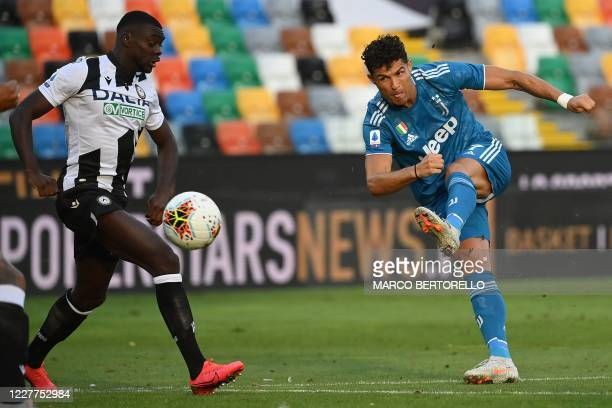 Juventus' Portuguese forward Cristiano Ronaldo kicks the ball during the Italian Serie A football match between Udinese and Juventus on July 23 at...