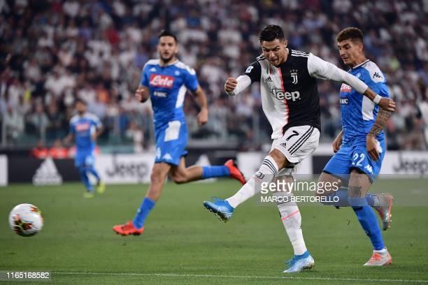 Juventus' Portuguese forward Cristiano Ronaldo kicks the ball in front of Napoli's Italian defender Giovanni Di Lorenzo during the Italian Serie A...