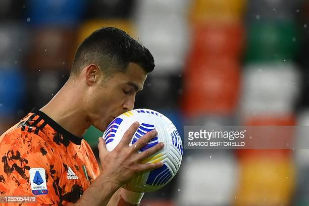 Juventus' Portuguese forward Cristiano Ronaldo kisses the ball during the Italian Serie A football match between Udinese and Juventus at the Dacia...