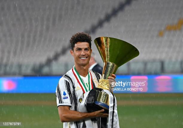 Juventus Portuguese forward Cristiano Ronaldo kisses the Champion's trophy at the end of the Italian Serie A football match Juventus vs Roma on...