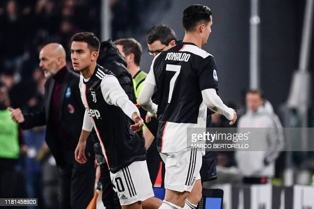 Juventus' Portuguese forward Cristiano Ronaldo leaves the pitch after being substituted by Juventus' Argentine forward Paulo Dybala during the...