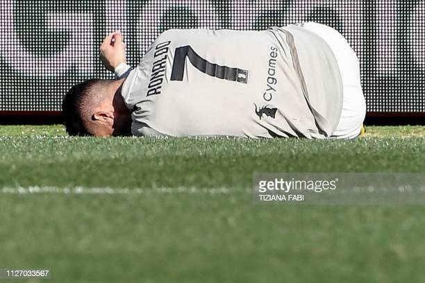 TOPSHOT Juventus' Portuguese forward Cristiano Ronaldo lies on the pitch after a shock during the Italian Serie A football match Bologna vs Juventus...