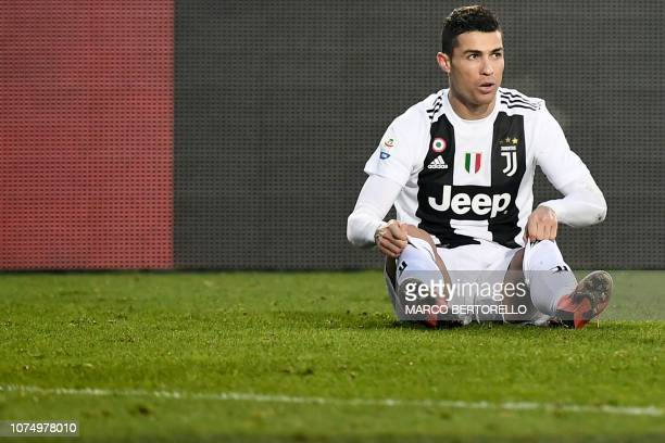 Juventus' Portuguese forward Cristiano Ronaldo looks on after being tackled during the Italian Serie A football Match Atalanta Bergamo vs Juventus on...