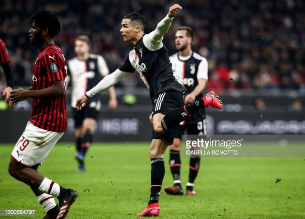 Juventus' Portuguese forward Cristiano Ronaldo looks on after shooting on goal during the Italian Cup semi-final first leg football match AC Milan vs...