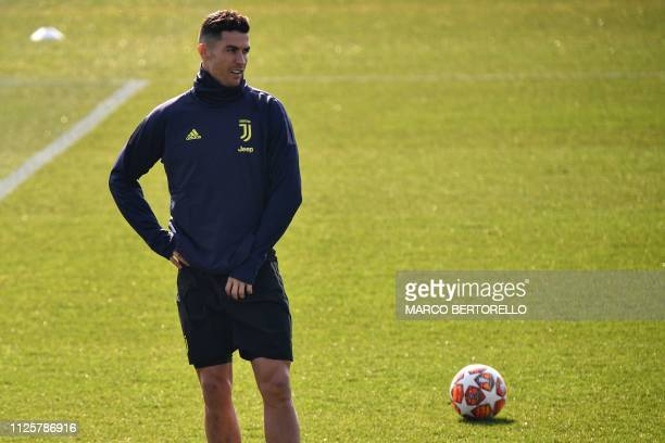 Juventus' Portuguese forward Cristiano Ronaldo looks on during a training session at the Continassa training ground in Turin on February 19 on the...