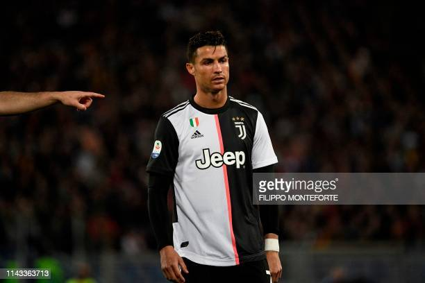TOPSHOT Juventus' Portuguese forward Cristiano Ronaldo looks on during the Italian Serie A football match between AS Roma and Juventus Turin at the...