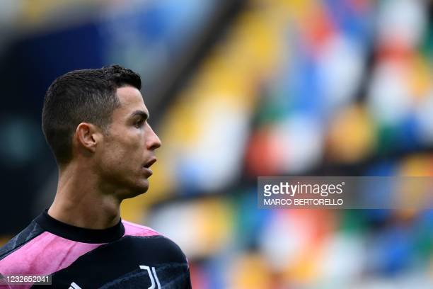 Juventus' Portuguese forward Cristiano Ronaldo looks on during the warm up before the Italian Serie A football match between Udinese and Juventus at...