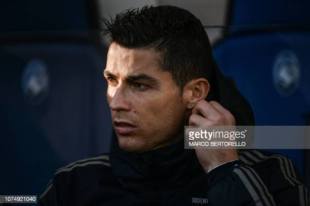 Juventus' Portuguese forward Cristiano Ronaldo looks on from the substitutes' bench prior to the Italian Serie A football Match Atalanta Bergamo vs...