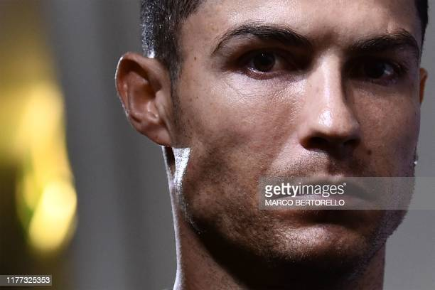 TOPSHOT Juventus' Portuguese forward Cristiano Ronaldo looks on within a press conference on October 21 2019 in Turin on the eve of Juventus' UEFA...