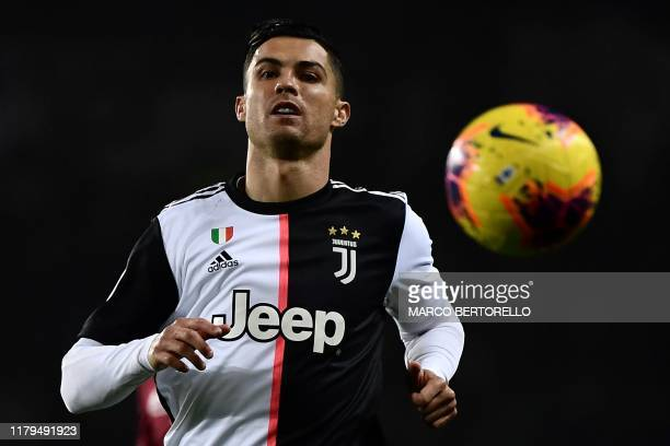 Juventus' Portuguese forward Cristiano Ronaldo looks the ball during the Italian Serie A football match Torino vs Juventus on November 2 2019 at the...