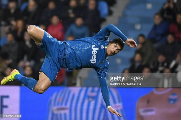 Juventus' Portuguese forward Cristiano Ronaldo loses balance after going for a high jump during the Italian Serie A football match SPAL vs Juventus...