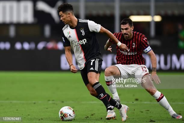 Juventus' Portuguese forward Cristiano Ronaldo outruns AC Milan's Italian defender Alessio Romagnoli during the Italian Serie A football match AC...